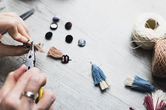 Crop hands making earrings