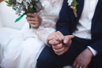 Crop hands of bride and groom
