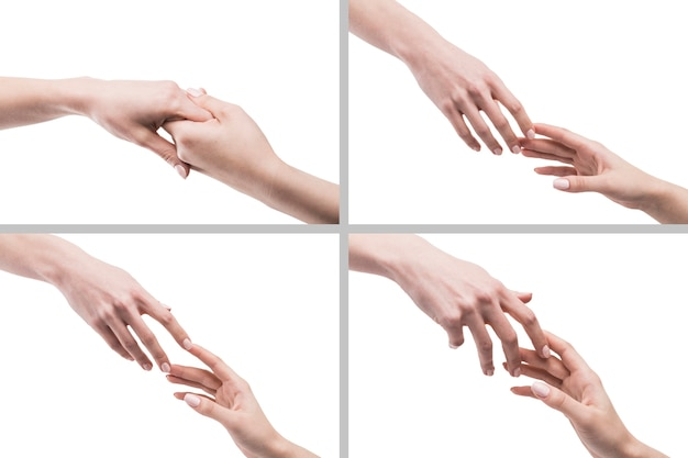 Crop hands reaching each other on white