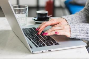 Crop hands using laptop