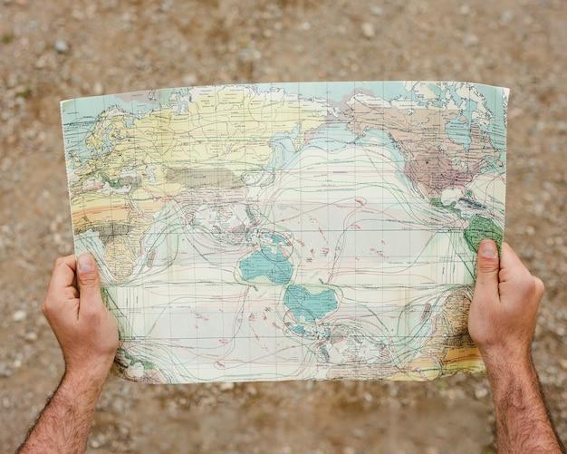Crop hands with map
