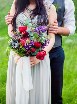 The crop image of romantic couple with flowers
