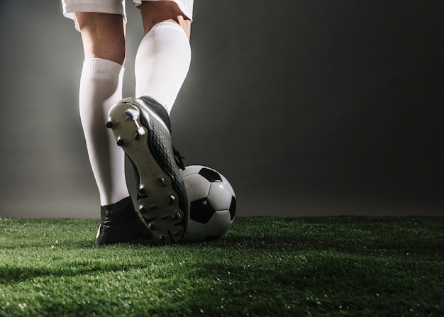 Crop legs and ball on field