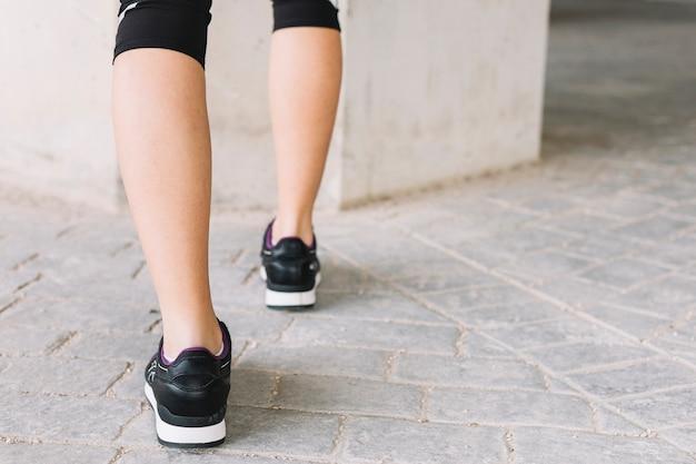Crop legs of exercising woman