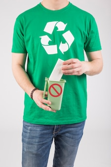 Crop man in green t-shirt with ecological sign