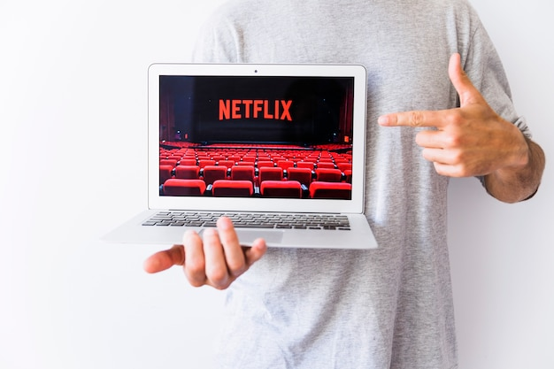 Crop man pointing at picture with netflic logo