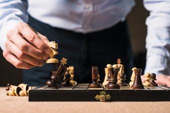 Crop man setting checkmate