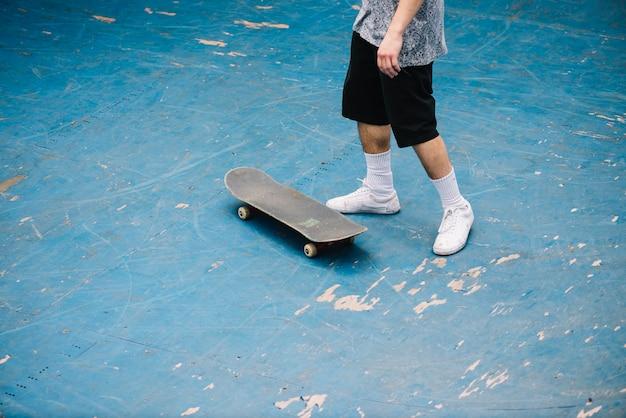 Crop man in skatepark