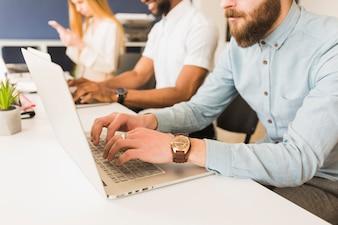 Crop men using laptops