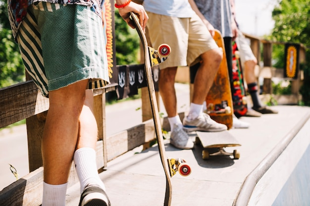 Crop people with skateboards
