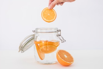 Crop person making infused water