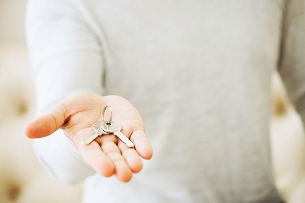 Crop person showing keys