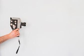 Crop person using retro camera