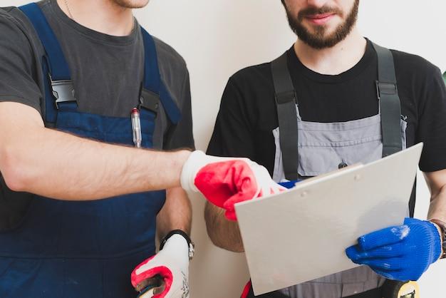 Crop repairmen working with tablet