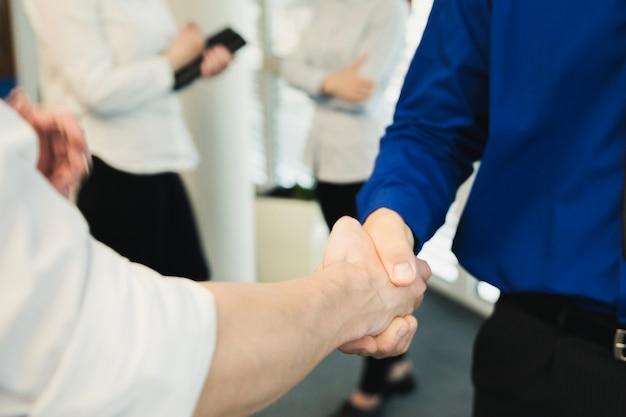 Crop shot of men shaking hands