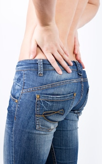 Crop topless female back in jeans