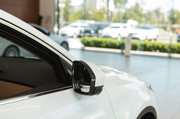 Cropped close up of a new car for sale or rental service at the dealership, copy space