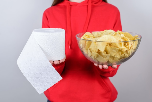 Cropped close up photo portrait of sad unhappy upset people person showing holding big large glass bowl plate with chips isolated gray wall