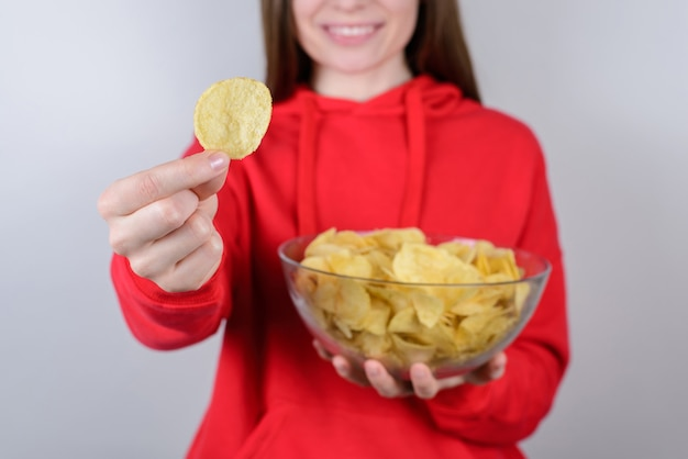 Cropped closeup photo of excited positive charming cheerful positive optimistic girl holding large big bowl isolated gray background