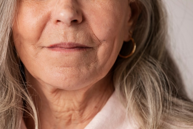 Cropped face of a happy senior woman