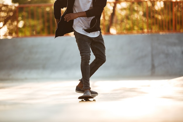 Cropped image of an african skateboarder skating