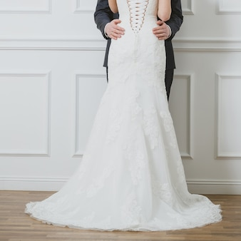 Cropped image of bride and groom in studio on a wedding day
