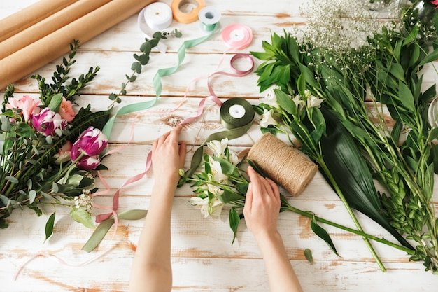 Cropped image of florist woman's hands