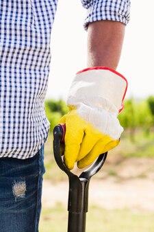 Cropped image of man holding shovel