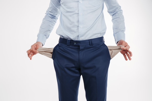 Cropped image of man showing empty pockets