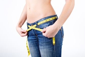 Cropped image of Woman measuring her waist