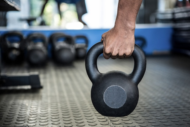 Cropped image of person holding kettlebell