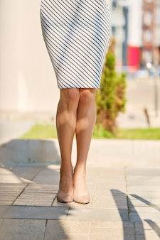 Cropped image of slim female legs outdoor