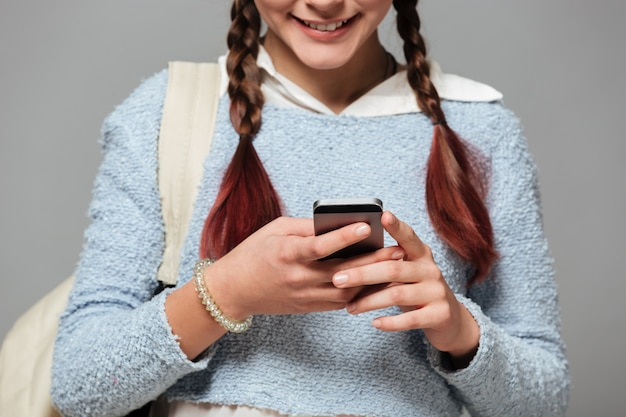 Cropped image of a smiling schoolgirl with backpack