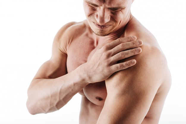 Cropped image of sportsman have a painful feelings in body.