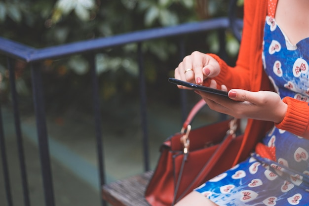 Cropped image of woman's hands holding mobile phone with blank copy space screen