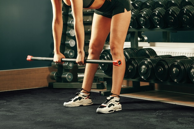 Cropped image of a woman training in a gym