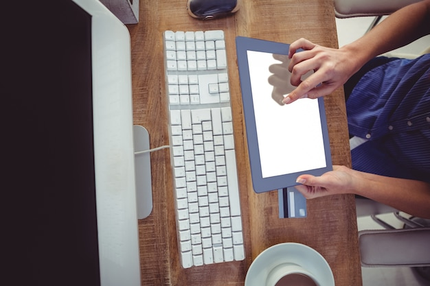 Cropped image of woman using tablet