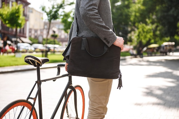 Cropped image of a young businessman with bag