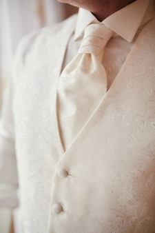 Cropped photo close-up men's waistcoat with white pattern. modern businessman