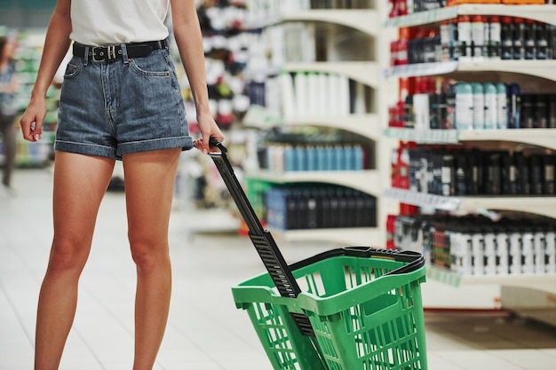 Cropped photo. female shopper in casual clothes in market looking for products.