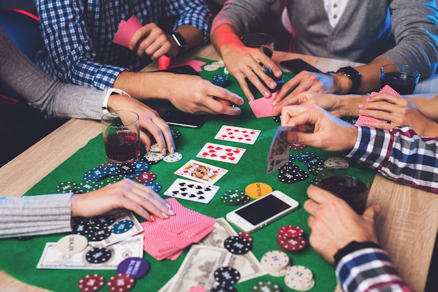 Cropped photo of poker concept with gamble players