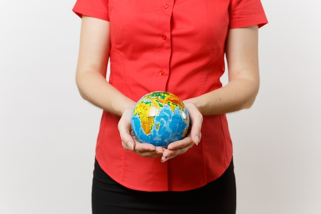 Cropped portrait of business woman in red shirt holding in palms earth globe ball isolated on white background. problem of environmental pollution. stop nature garbage, environment protection concept.