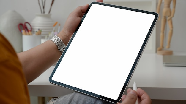 Cropped shot of male artist working on vertical blank screen tablet with stylus pen