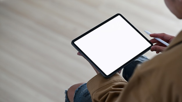Cropped shot man holding digital tablet empty screen and stylus pen