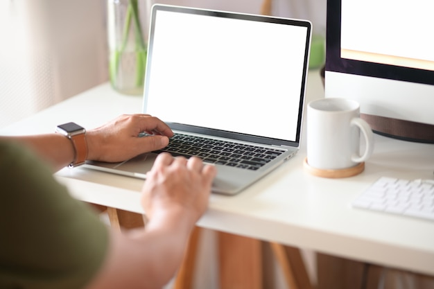 Cropped shot of man working with laptop