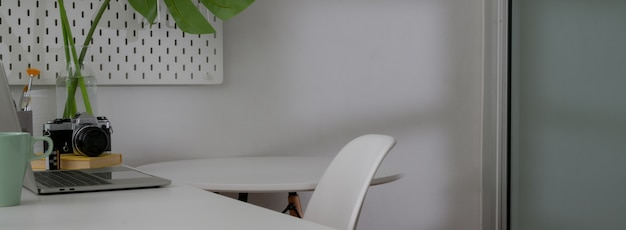 Cropped shot of minimal home office interior design with white worktable