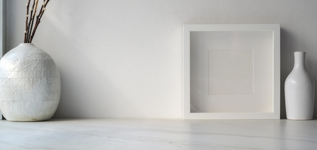 Cropped shot of minimal workspace with mock up frame and ceramic vases decoration on white wooden table with copy space