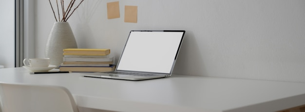 Cropped shot of portable workspace with  laptop, books, decoration and copy space