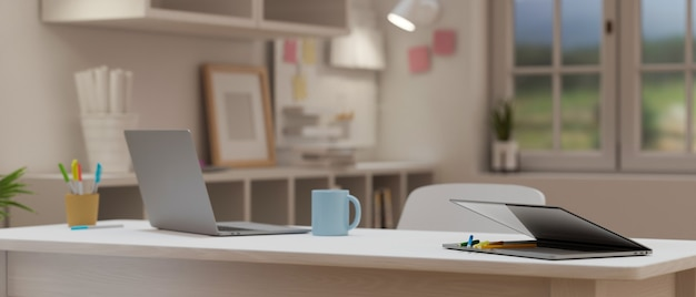 Cropped shot of portable workspace with laptop on wooden table in cozy office room