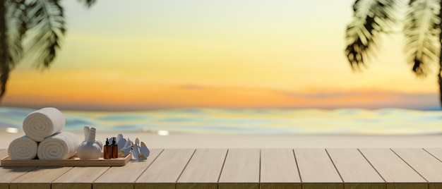 Cropped shot of spa accessories on wooden table and copy space with sea background, summer concept